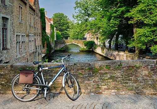 Luxury Barge Cruising - Bike near canal Bruges